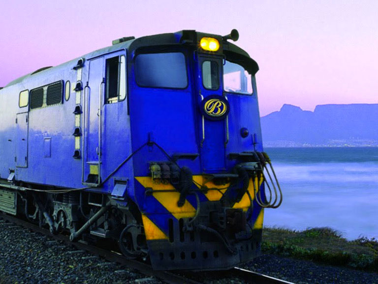South Africas Luxurious Blue Train passing Cape Town
